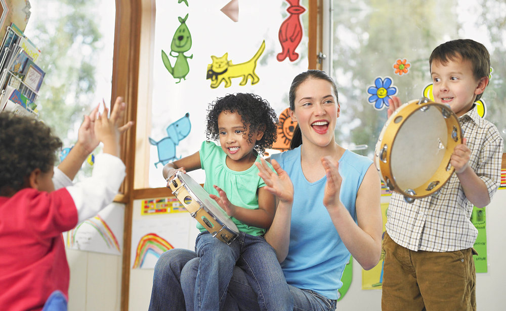 Teacher in his students playing